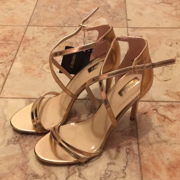 40d6c5cdd78f  NEW  Rose Gold Faux Leather Criss-Cross Heels. NWT. Forever 21.  8  25.  Size. 10